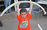 Child holding whale bone
