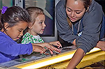 Children at the Aquarium touch tanks