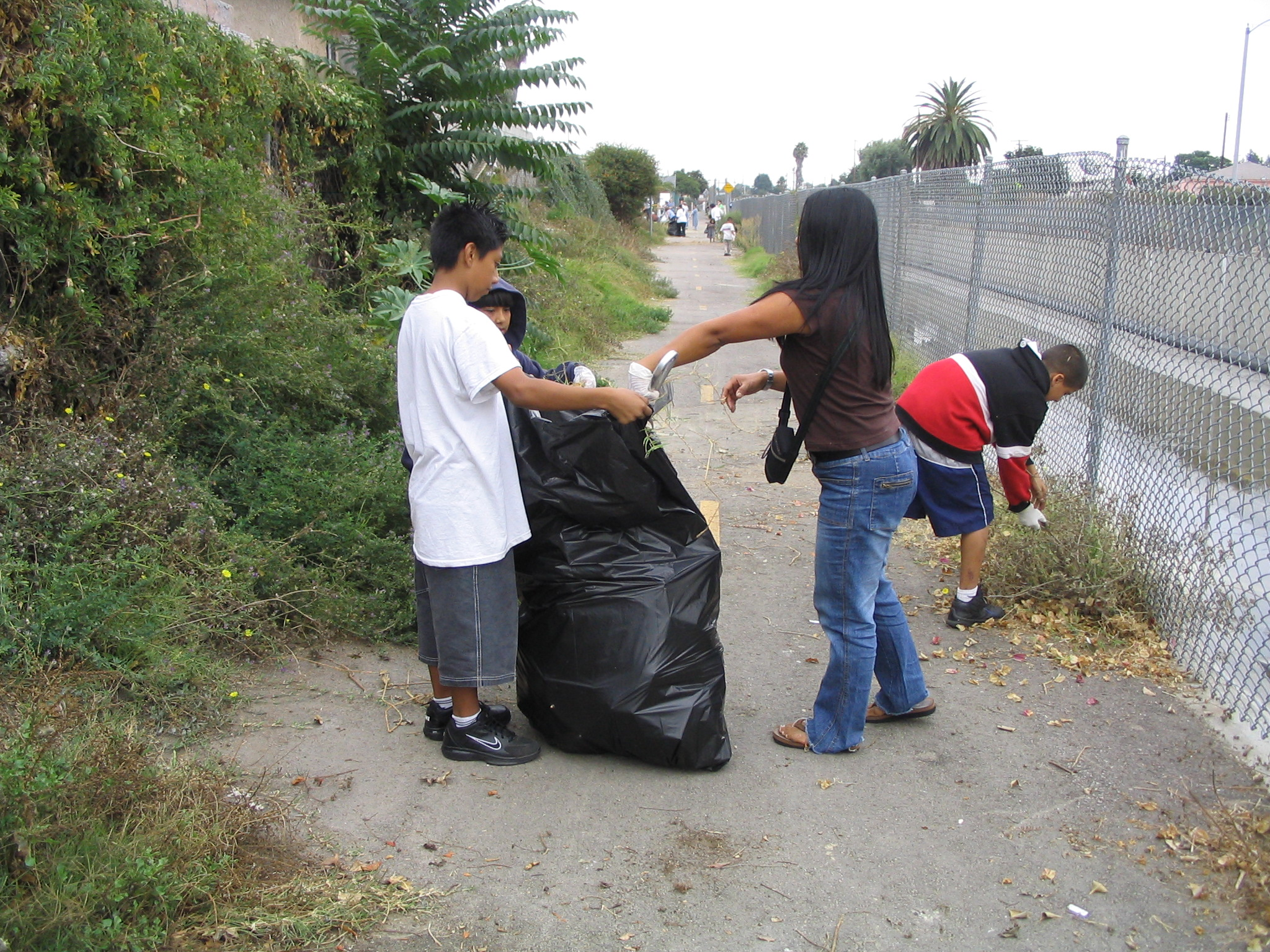 Cleaning up the bike path along Compton Creek.