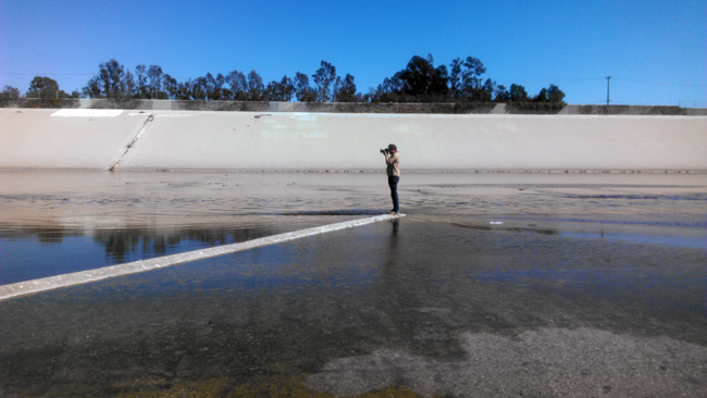 Heal the Bay CEO Ruskin Hartley photographs the LA River