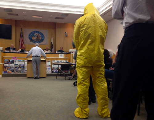 Activist in Hazmat suit at hearing Keep Hermosa Hermosa Campaign to Stop Oil Drilling