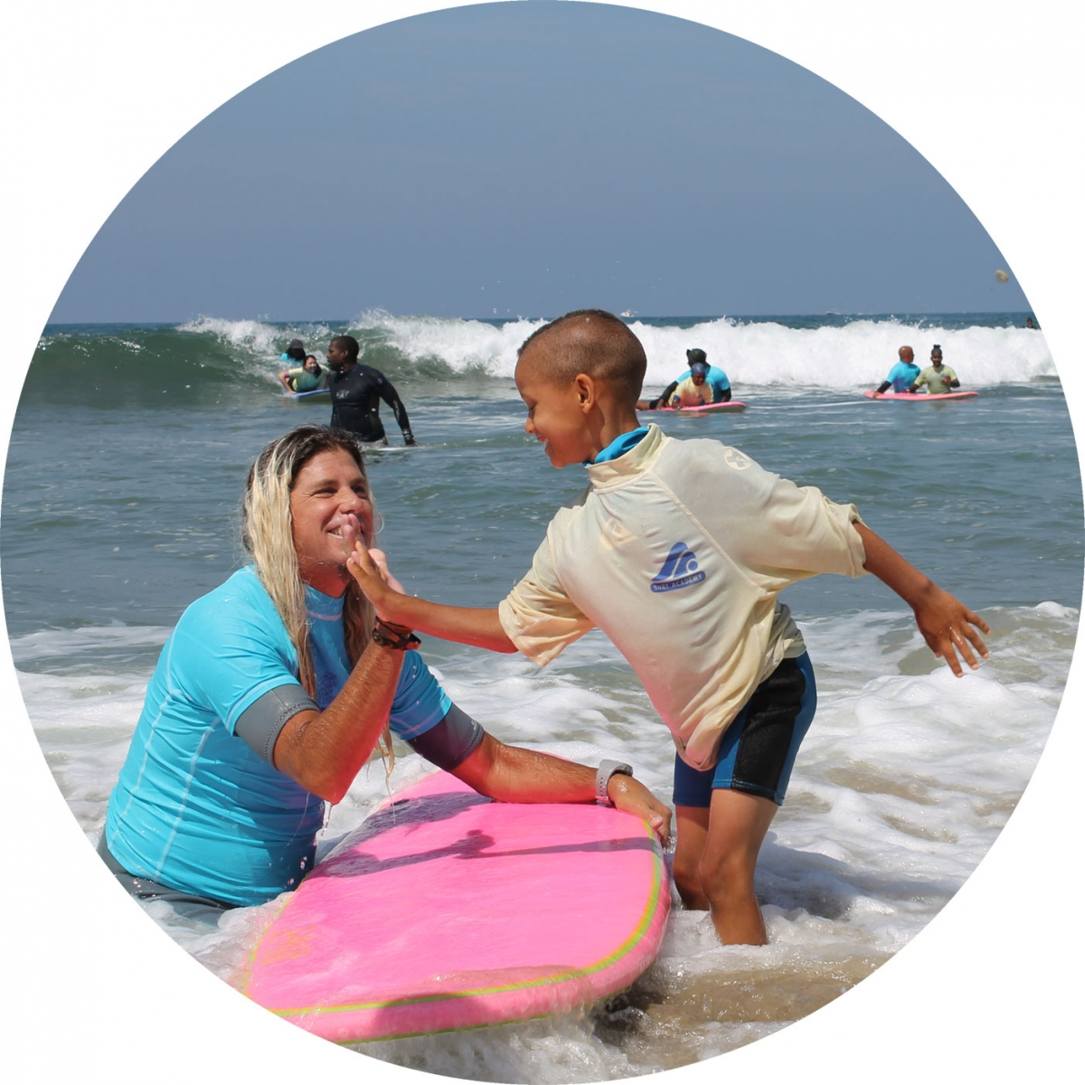 Surfing lesson high-five at Nick Gabaldon Day
