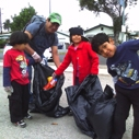 A family cleans up together in South LA at Coastal Cleanup Day on Sept. 17
