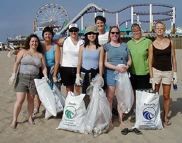 Volunteers take a break from a beach cleanup at the Santa Monica Pier