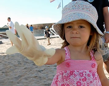 Toddler at a beach cleanup